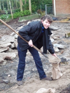 Site staff and keepers lend a hand with sandbags - Lisa from zoo site staff helping out with the World War Zoo gardens project, Newquay Zoo, December 2009