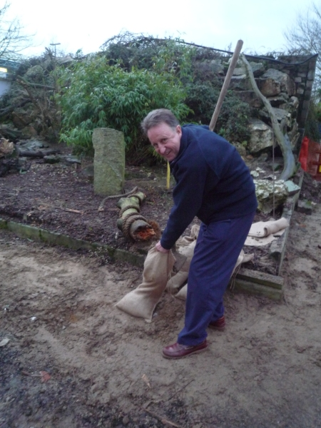 Adrian our Operations manager waylaid to lend a hand with the sand(bags) for the World war Zoo keeper's garden! Newquay Zoo, Dec. 2009
