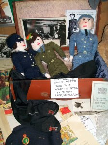 ATS, WAAF and WREN woollen dolls handknitted from wartime patterns for the event by Dianne Eade at Newquay Zoo, in one of our  original wartime suitcases. WAAF silk bloomers and precious unissued CC41 Rayon stockings formed part of this popular women and children section of the display. Handwritten labels marked the section of the weekend when we were runnning out of voice from talking for three days! Copyright: World War Zoo weekend, Newquay Zoo