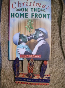 A rare survival of a cardboard Christmas stocking toy in our World War Zoo gardens collection alongside the excellent Christmas on the Home Front book by Mike Brown