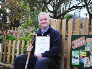 Newquay Zoo's wartime gardener and blogger Mark Norris with the BIAZA award for best plants in a landscape feature and design.