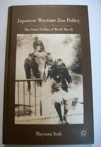 Gas masks for Japanese zoo elephants on the cover of Mayumi Itoh Japanese zoo wartime book