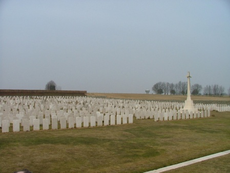 Dexter is buried in the rows of graves to the left of the Cross of Sacrifice at Bienvillers Military Cemetery. Image www.cwgc.org