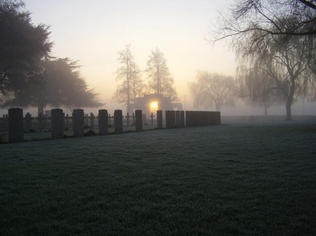 S.M. Toppin lies buried in this cemetery, an atmospheric photo showing only a  few of the 9901 WW1  graves at Lijssenthoek Cemetery, Belgium. (Image www.cwgc.org)