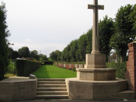472712 Private Robert Jones' gravestone is just behind the Cross of Sacrifice in this picture of the tiny Gouy en Artois Cemetery near Arras. Image: cwgc.org