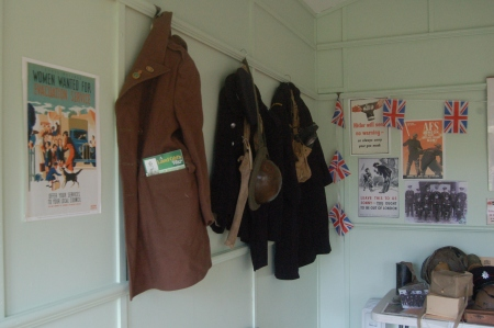 Land Army, Fire and Civil Defence Greatcoats and uniforms hung ready for a schools workshop, World War Zoo Gardens