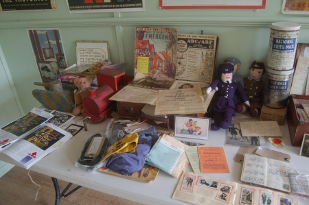' Evacuee' suitcases with original handmade wartime toys, ARP advice and blue WAAF silks!  World War Zoo Gardens workshop, Newquay Zoo (Picture: Lorraine Reid, Newquay Zoo)