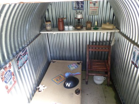 Everyday 1940s items in the Trengwainton wartime garden Anderson shelter  open for  display, 2014. Image - WWZG.