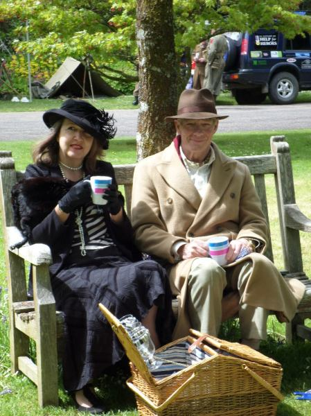 A nice cup of tea and a sit down, listening to the 1940s singalong, complete with period picnic basket, Trengwainton, 2014. Image WWZG