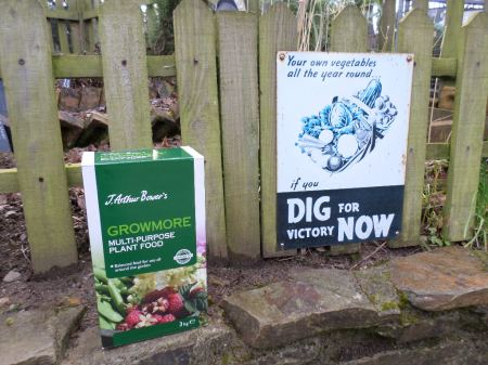 Modern Growmore next to the campaign signs of what replaced the National Growmore Campaign, Dig For Victory!  World War Zoo Gardens Project, Newquay Zoo,  January 2015