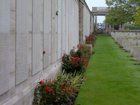 Some of the many names panels on 15 foot high walls surrounding Dud Corner Cemetery's headstones - the Loos Memorial to the missing of this 1915 battle. (Image Source: CWGC)